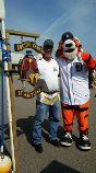 """Eric and the Detroit Tiger mascot """"Paws"""" in front of our booth"""