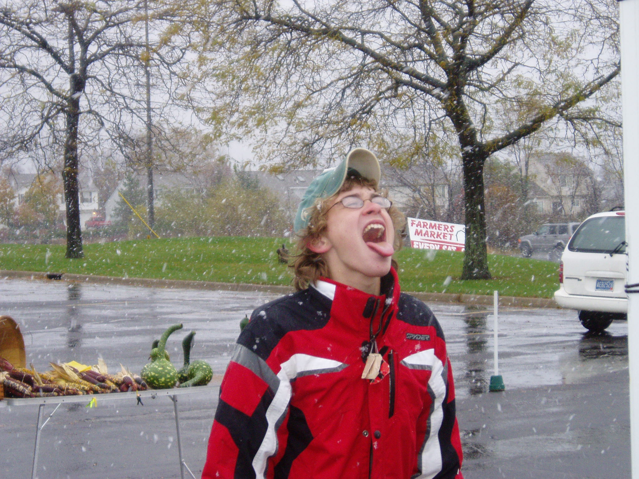 a 4-H member catches snowflakes during the market