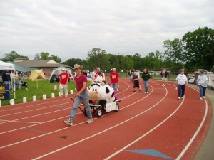 Steven walking on the track while pulling a wagon