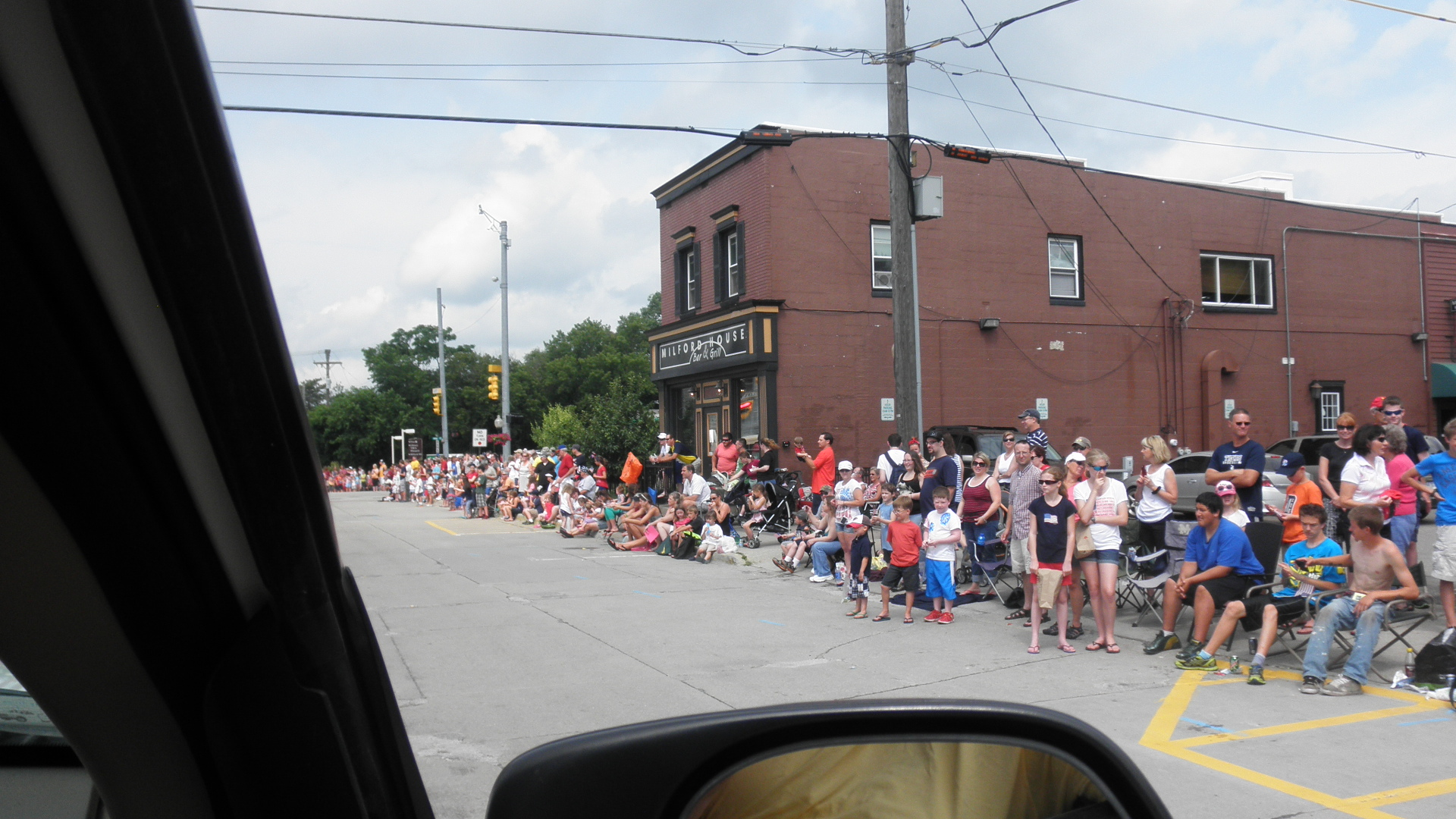 lots of people lining the street to see the parade